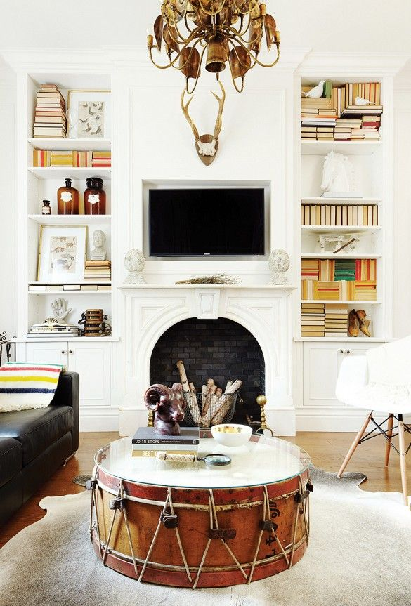 Alternatives to coffee table fatigue! Large marching band drum as a coffee table and built-in shelving…other cool ideas!