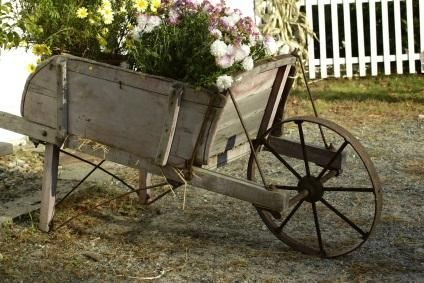 Google Image Result for http://cf.ltkcdn.net/antiques/images/std/131740-424x283-wooden-wheelbarrow.jpg