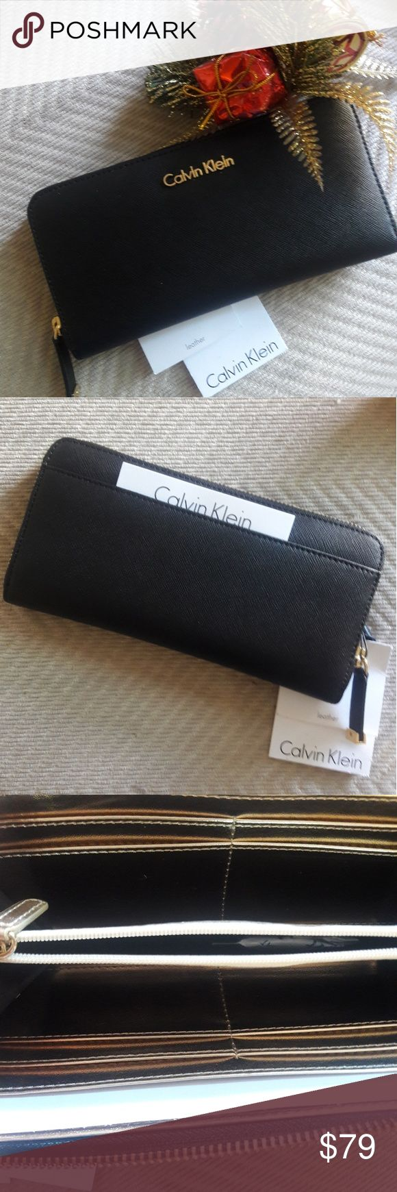 "New Calvin Klein Logo Zip Wallet Case Organizer Brand New Hard To Find  With Tag  Calvin Klein Logo  Women's Wallet Case Organizer  Safiano Leather  Black Color  Round Zipper Closure  Slip Pocket On The Back  8""L × 4""H × 3/4""W Original Price is $98 + Tax Great Idea For Gift! Please Feel Free To Ask Questions Calvin Klein Bags Wallets"