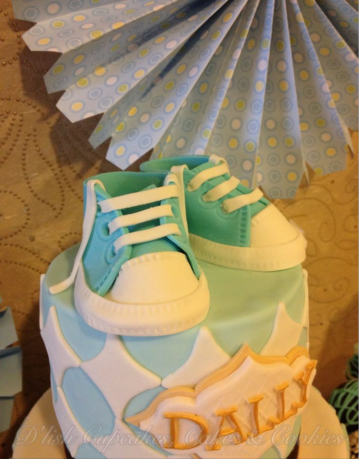 Hand crafted sugar gym boots by D'lish Cupcakes