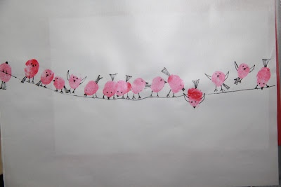 thumbprint red birds on wire