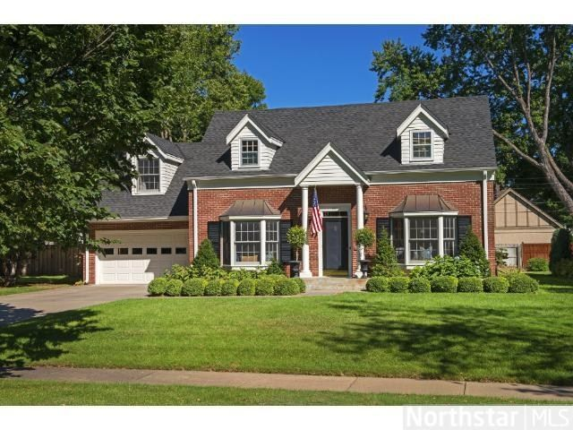 Classic red brick cape cod just perfect curb appeal for Cape cod exterior