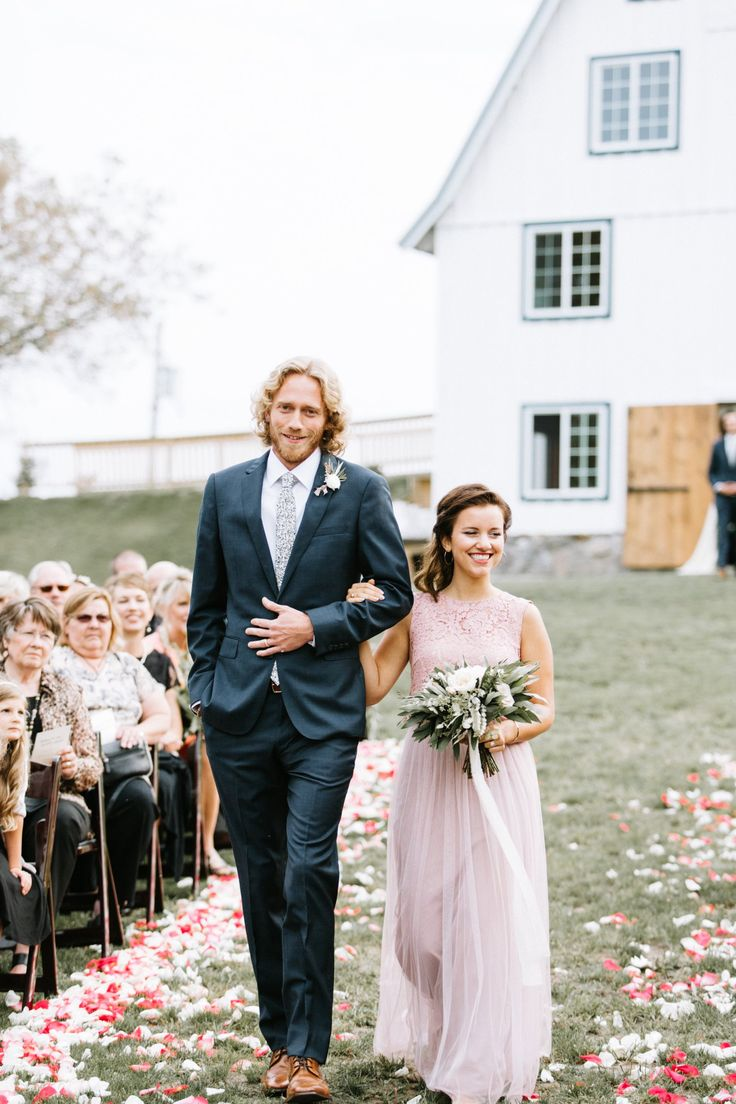 lace top light pink bridesmaid dress with flowy seethrough skirt with navy groomsmen suit | Bloom Lake Barn in Shafer, MN | Kate Becker Photography, Minneapolis Wedding Photographer