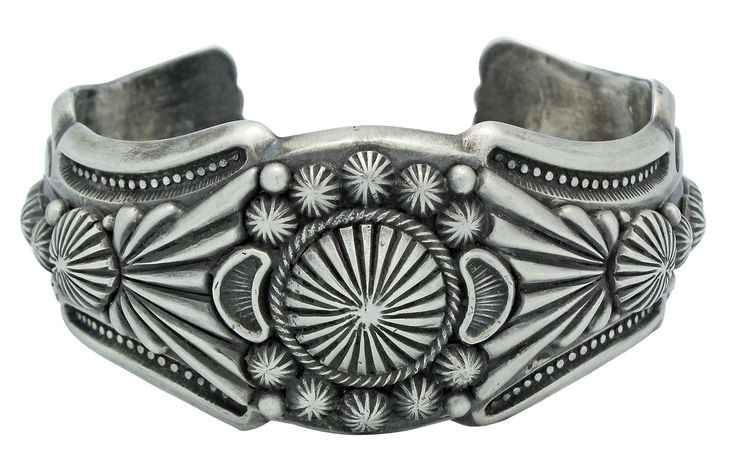 Harry H Begay, Silver Ingot Hammered Cuff, File, Stamping, Cutouts, Navajo, 7 in. All Sterling Silver, handmade. Created by Navajo artist Begay, Harvey H. Handcrafted in the US by Native American artisans. Bracelet fits a 7in wrist. The widest point is 1.25in, and the gap is 1in. Authenticity and quality backed by the standing and tradition of Perry Null Trading Company.