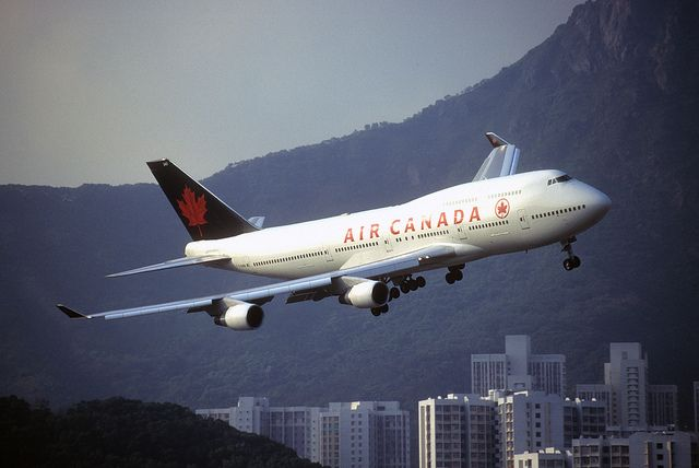 "Air Canada 747-433 ""C-GAGN"" hauls itself out of the turn for runway 13 Kai Tak, by 'Longreach' by Jonathan McDonnell, via Flickr."