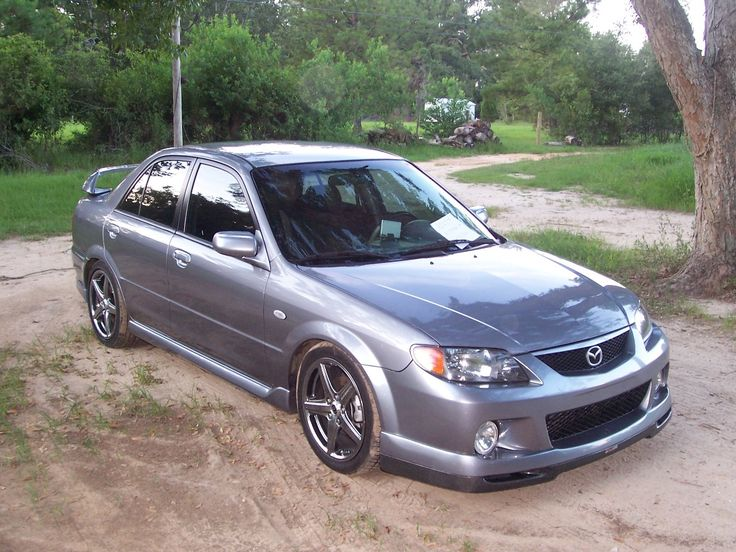 2003.5 Mazda MAZDASPEED Protege 4 Dr Turbo Sedan. My second favorite car. This car could scoot! Responsible for my biggest speeding ticket. Would still have it if it hadn't going flying and met a pole