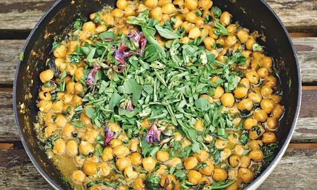 A revelation: Yotam Ottolenghi's chickpea stew with wet garlic, sage flowers and broad bean tops. Photograph: Julian Anderson for the Guardi...