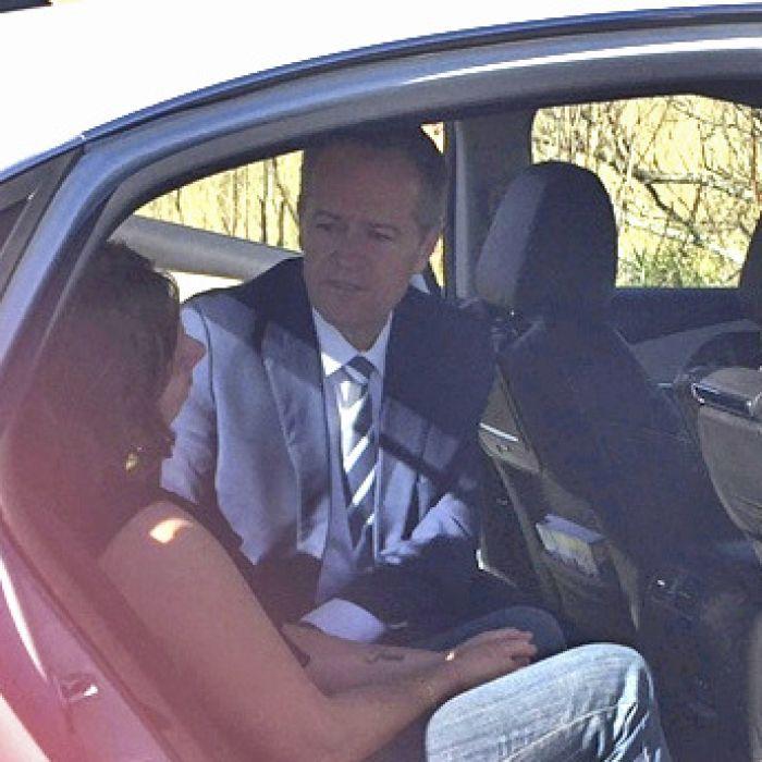 Bill Shorten comforts a woman after crash near Newcastle