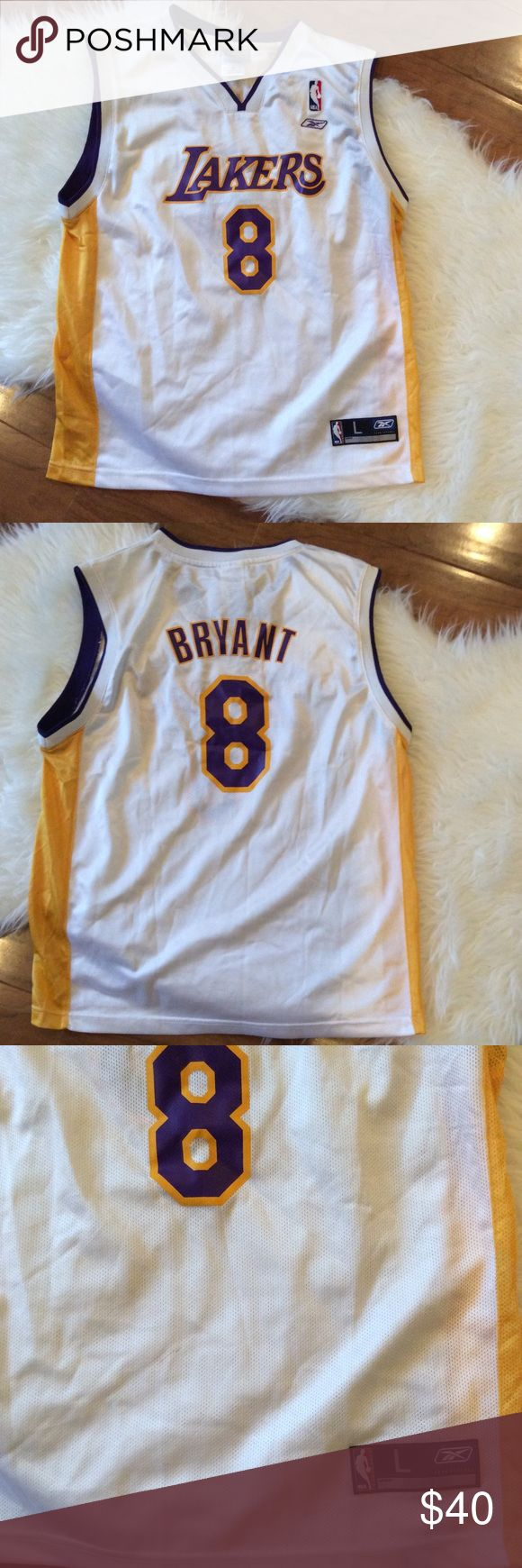 """Reebok Kobe Bryant Jersey Condition: gently worn but in good overall condition. There is a small stain on the bottom front of the jersey. Can be seen in the third picture. Approx measurements: Labeled as Large (14-16) pit-to-pit: 20"""" Length: 25 1/2"""" B:4 NO TRADES OR MODELING Reebok Tops"""