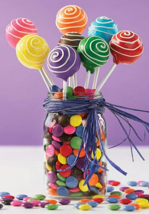 Was just thinking that id we took out the brown m m's this might be an easy way to make some colorful decorations. Dollar store vases filled with them and maybe something (like cake pops but really anything) on top?