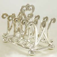 Silver Toast Rack by Wakely & Wheeler 1896  Antique silver toast rack by English silversmiths Wakely & Wheeler. As you can see the dividers are shaped as the Letter W. This was a set of two and the W representing their initials.