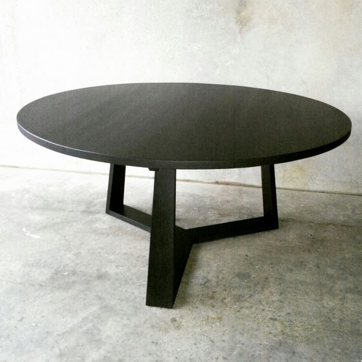 PURE dining table in ebonized black finish by RZID interiors