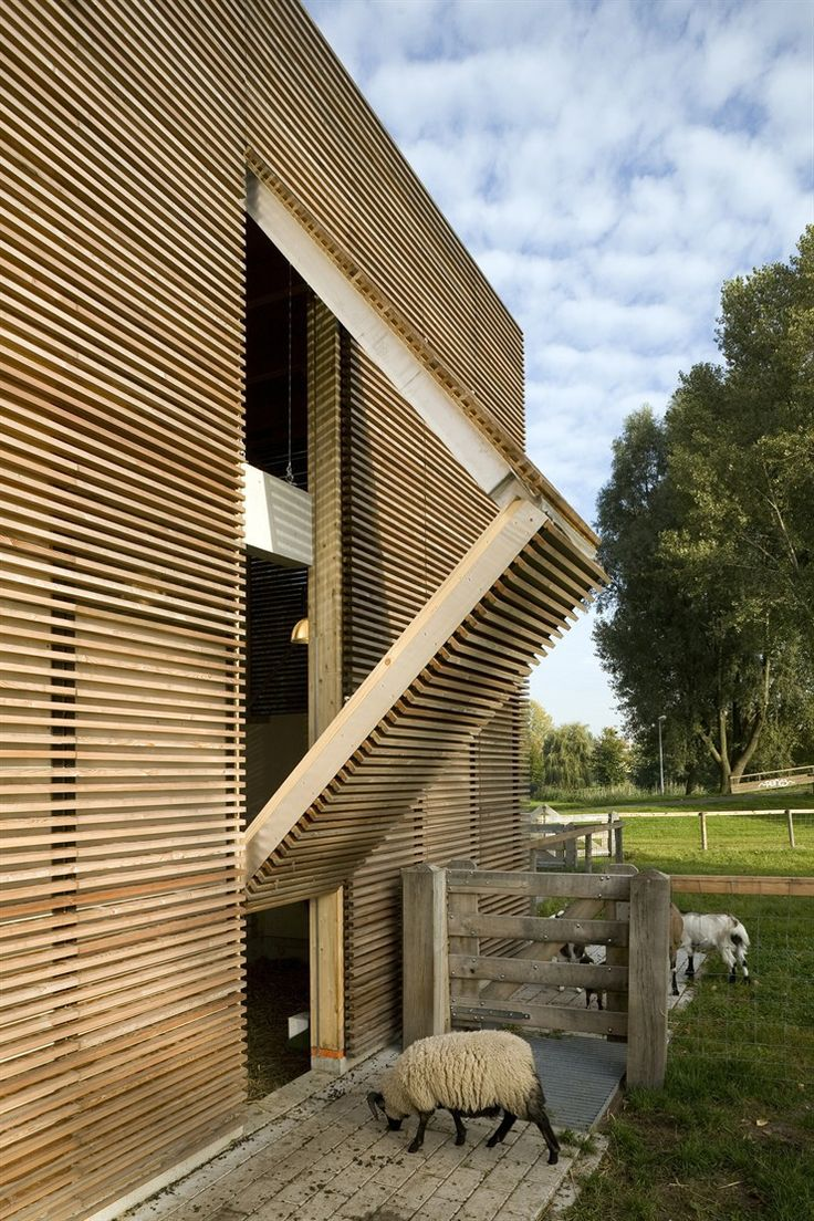 Wooden box with an open facade system