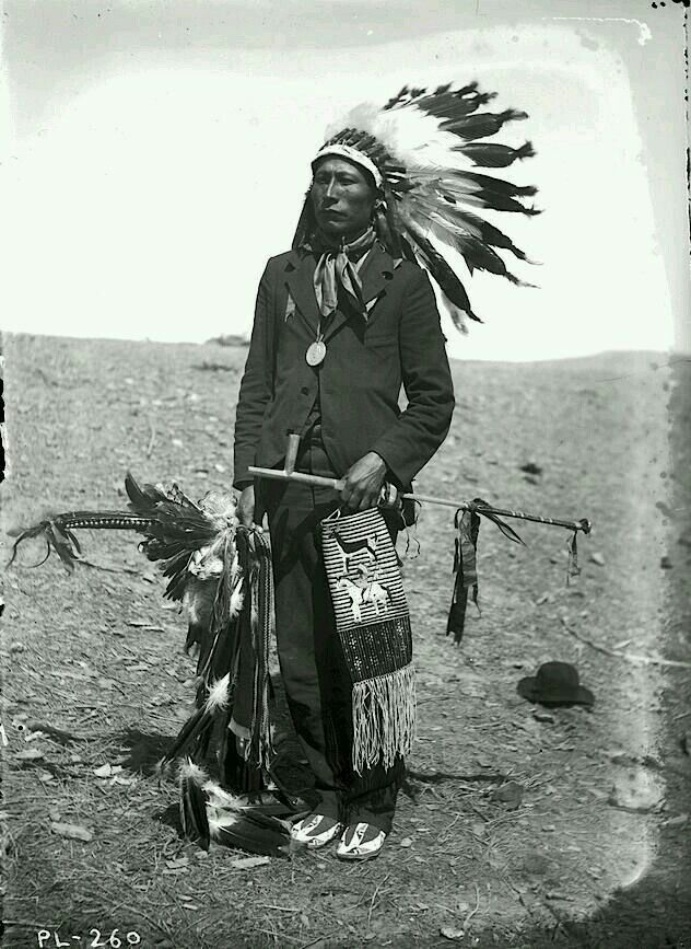 """Two vastly different world's, different cultures,  assimilated by the Man,  adapting to Euro/American or vanish,  great dignity. Pipe stem being together with pipe bowl is considered """"loaded"""",  sacred. He was most likely told to pose this way with pipe and Stem together,  peace medal,  stylized pipe bag,  dance/Quilled pieces  in right hand,  Wasicu's (white man) suit  clothes. (In Lakota Sioux,  Milá Hánská translates """"long knife/knives"""" words for calvary soldiers with swords. (my words…"""