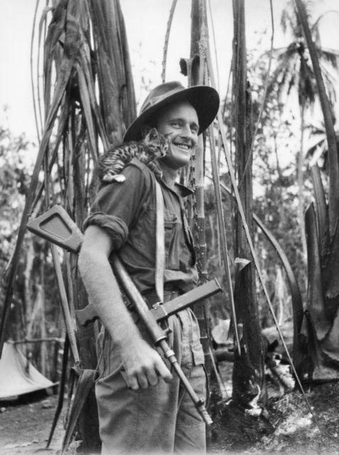 Australian soldier with an Owen Gun. And a cat