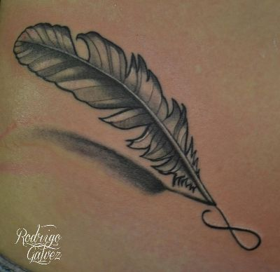"""I'd like the quill to be drawing the infinity sign like this.. and the words """"This too shall pass"""" underneath in two lines..but the feather is boring.. ;)"""