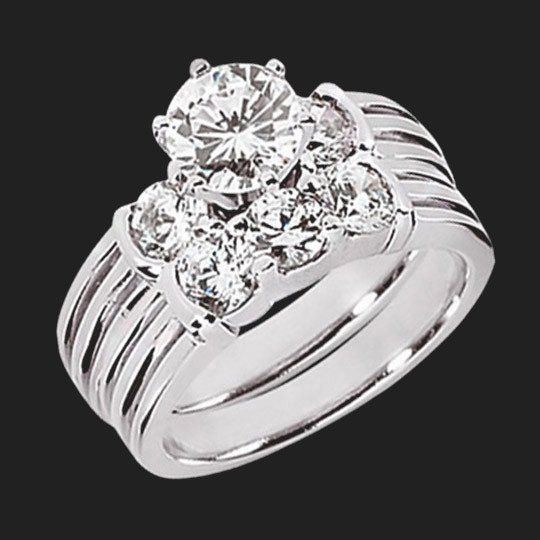 The Amanda Wedding Set features the beautiful engagement ring and wedding band, which have bar set 0.25ct Diamond Hybrid® side stones on a grooved shank.|This band looks beautiful by itself or when worn with the engagement ring. You receive a 20% off discount off the wedding band when purchased with the engagement ring.|Engagement RingMetal Weight: 6.3gr. Band Width: 4.5mm.Side Stone Carat Weight: 0.50ct.Wedding BandMetal Weight: 5.0gr. Band Width: 4.05mm.Side Stone Carat Weight: 0.75ct.