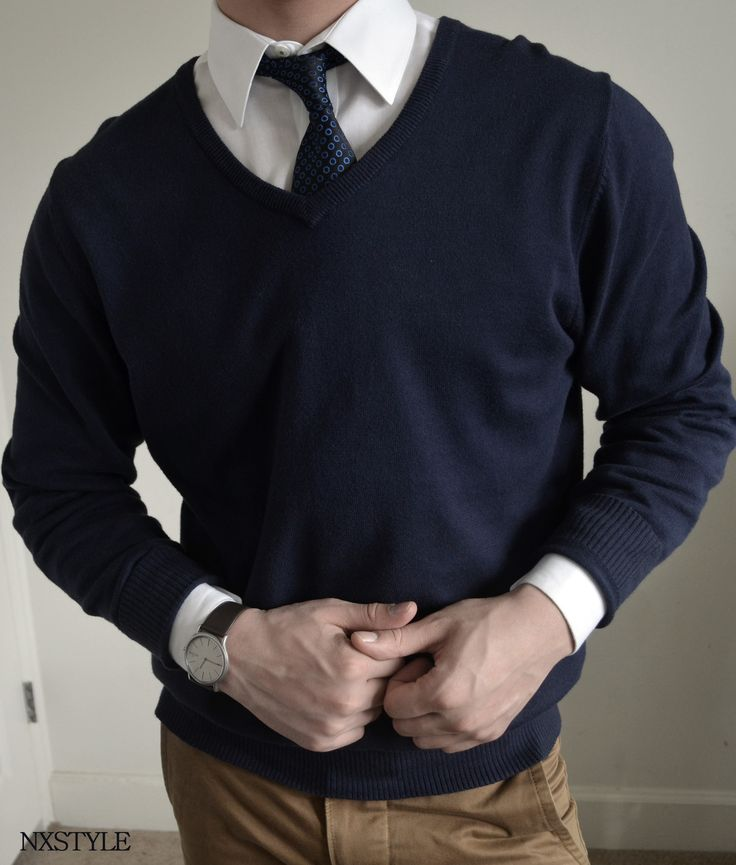 Shop this look for $122:  http://lookastic.com/men/looks/white-dress-shirt-and-navy-tie-and-navy-v-neck-sweater-and-tan-chinos/391  — White Dress Shirt  — Navy Tie  — Navy V-neck Sweater  — Khaki Chinos