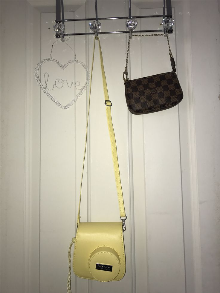 Hooks from Homebase , camera from John Lewis ,case from Amazon, little bag from Louis Vuitton, not sure where there heart sign is from ❤️❤️