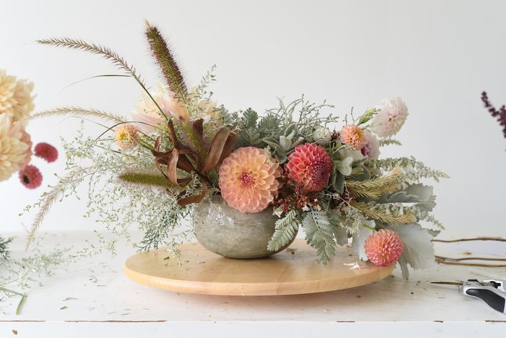 centrepiece, table flowers, fountain grass, dahlias, dusty miller, artemisia, wormwood, grey foliage, peach, apricot, rustic wedding