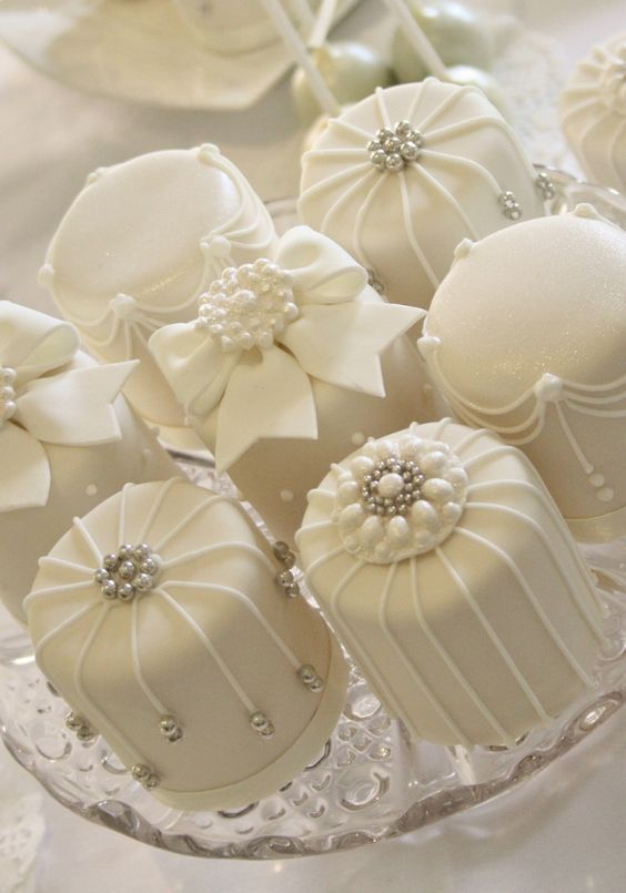 Featured Cake: Cotton & Crumbs; Sophisticated studded mini white cream wedding cakes