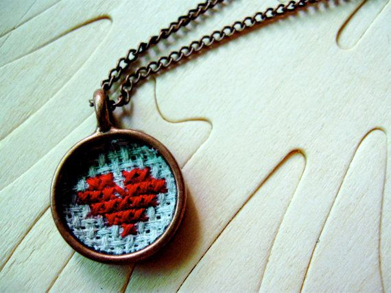 Way cool cross stitch necklace!