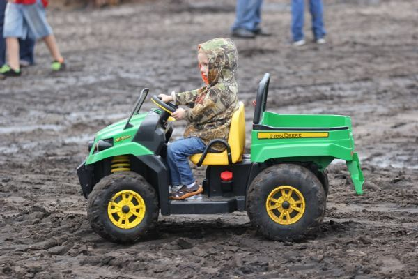 Kid On Power Wheels John Deer Gator