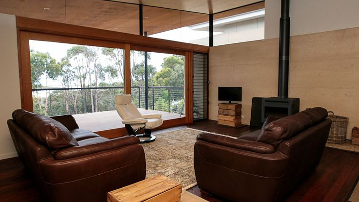 Rammed Earth, Timber window frames, country style holiday home, architecture