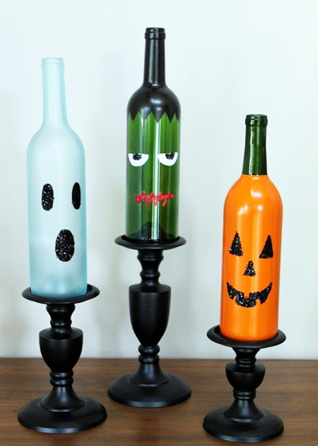 Make a set of Halloween wine bottles as fall home decor with this easy DIY project.