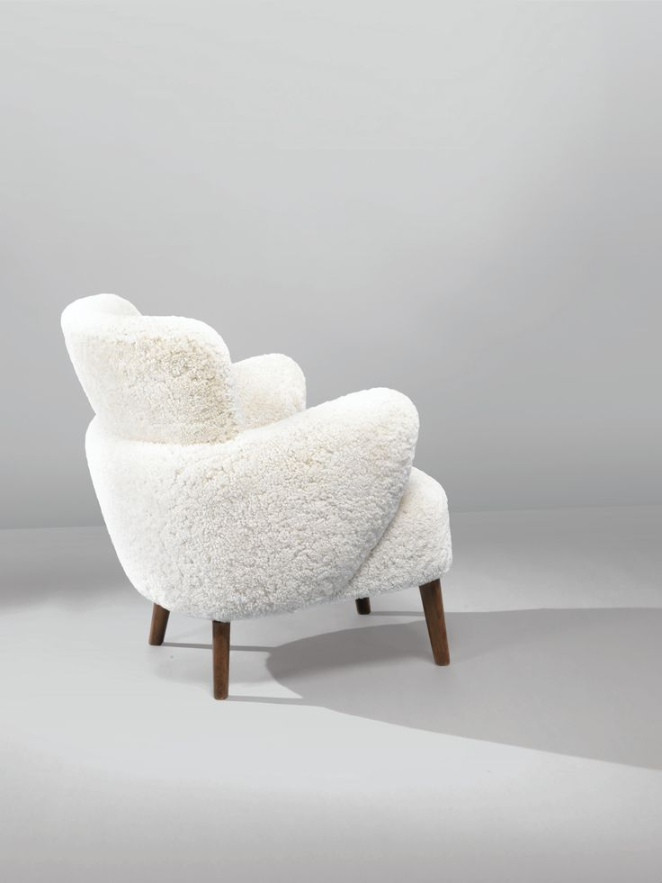 Flemming Lassen Attributed; Wood and Sheepskin Easy Chair, c1940.