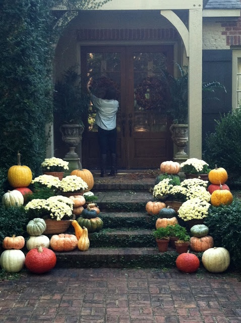All Things Farmer gets ready for a fall baby shower with pumpkins, mums, and wreaths.. oh my!