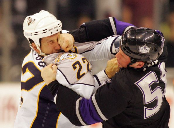 This is what happens when emotions run high in hockey somebody loses teeth