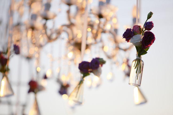 Dangling Flowers in dusk a by Tirtha Bridal Uluwatu Bali