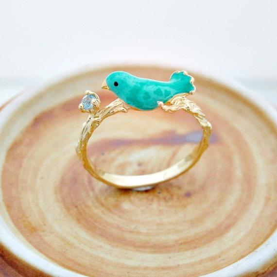 blue topaz ring with tweeting bird on branch