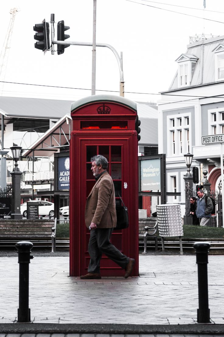 https://www.philedie.com/   Incoming Call  Contact Unknown.  ___________________  Canon EOS-1Ds Mark II EF 24-105mm f/4L IS USM f/4 1/160 sec. ISO-100 82mm  #photography #documentary #urban #composition #symmetry #balance #red #phonebox #man #walking #motion #city #wellington #newzealand #nz