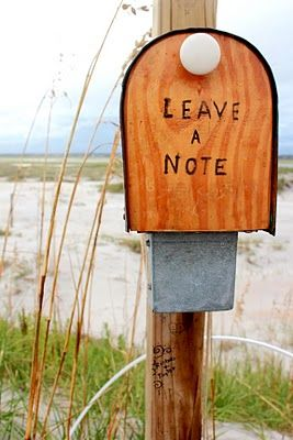 A mailbox with a notebook in it where people from all walks of life leave their stories. Wrightsville Beach.