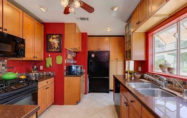 red walls, oak cabinets, black appliances | Red kitchen ...