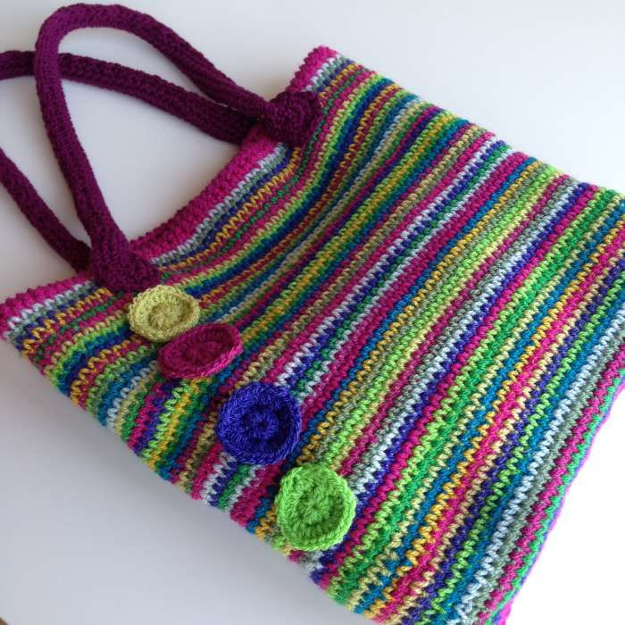 Rainbow crochet tote Stylecraft rosette position. This is the UK version but she has inserted US equivalents in parenthesis where needed. Hope you can adjust.