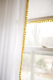 Found curtains with these pom pom at target..SO CUTE but the curtains are a funky yellow color..def. go with my bohemian room!