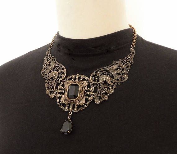 Gothic Angel Wings Necklace - Gothic Jewelry in Brass - Filigree Large Gothic Wings Necklace - Statement Necklace - Black Swarovski Necklace - Womens Gift by https://www.etsy.com/shop/LeBoudoirNoir  It was love at first sight... When I first saw these rare French filigree wings, I could not resist the temptation to purchase them and create a large, statement necklace. So here it is, dark and gorgeous, to compliment any of your Gothic outfit. A round filigree component, wit...