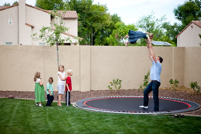 Love this backyard!  Maybe we should put our trampoline in the ground and get some fake grass.  Wish it didn't cost so much to have real grass in AZ!
