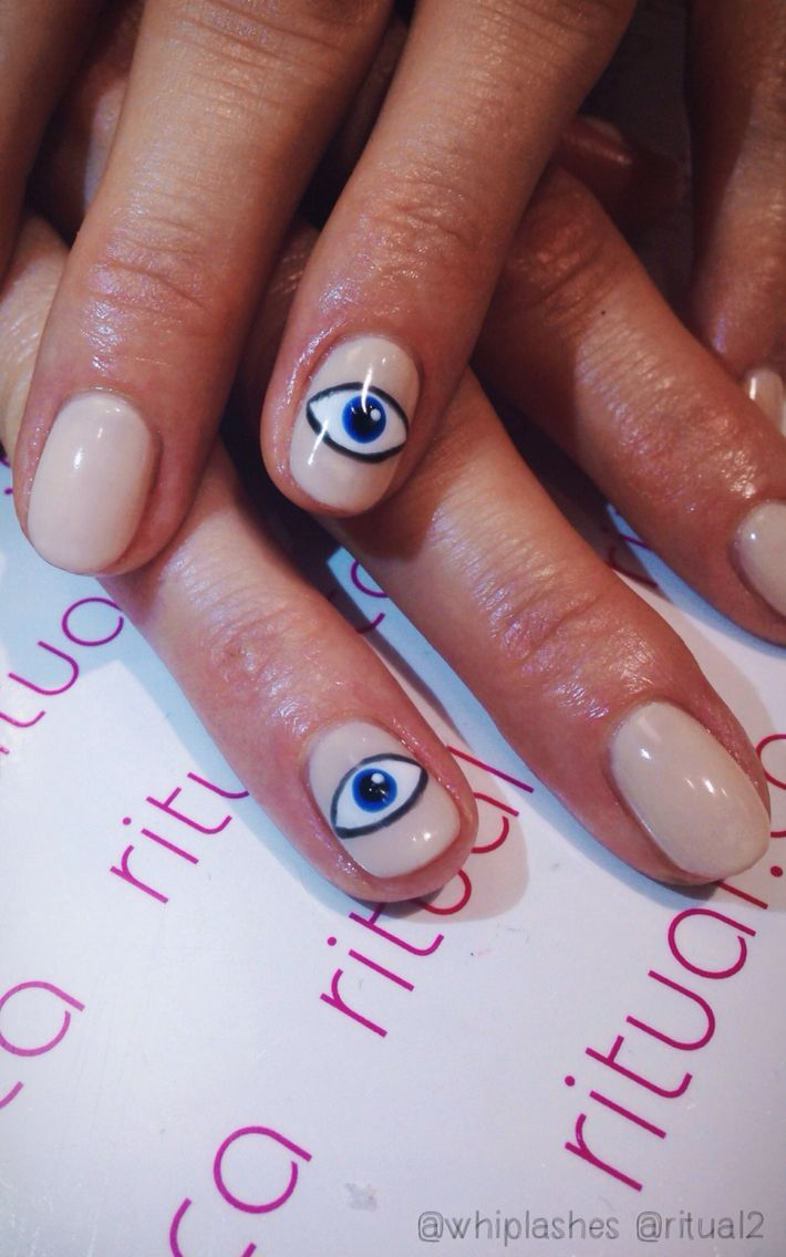 Warding off negativity with some evil eye nail art.