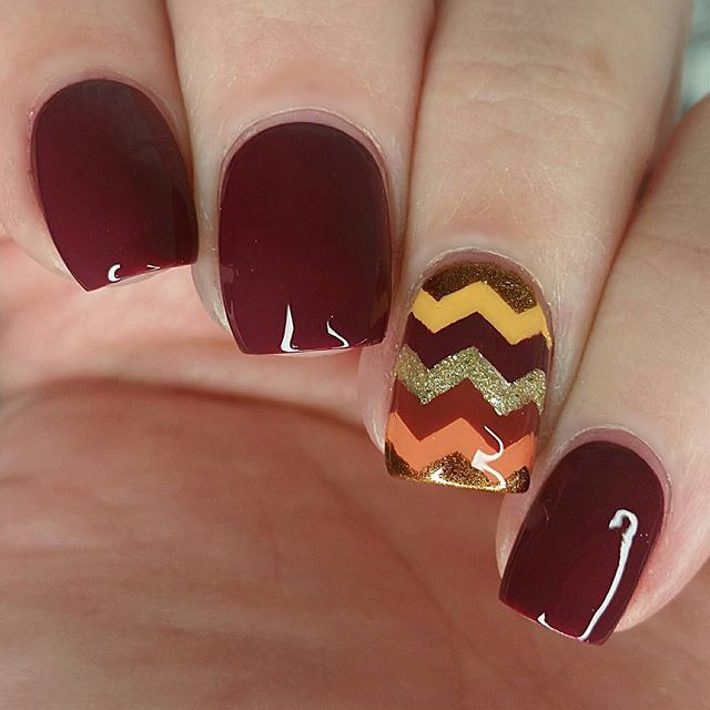 """Multi-colored chevron perfect for Fall or Thanksgiving =) longer video with steps is on YouTube, link in bio  - - Products used: Orange: """"Where Did Suzi's Man-go?"""" OPI Yellow: """"I Just Can't Cope-acabana"""" OPI Burgundy: """"Jump In My Jumpsuit"""" Essie Burnt Red: """"Sienna"""" LVX Copper: """"Leggy Legend"""" Essie Gold: """"My Favorite Ornament"""" OPI Chevron vinyls: From @Whatsupnails Top coat: HK Girl @Glistenandglow1"""