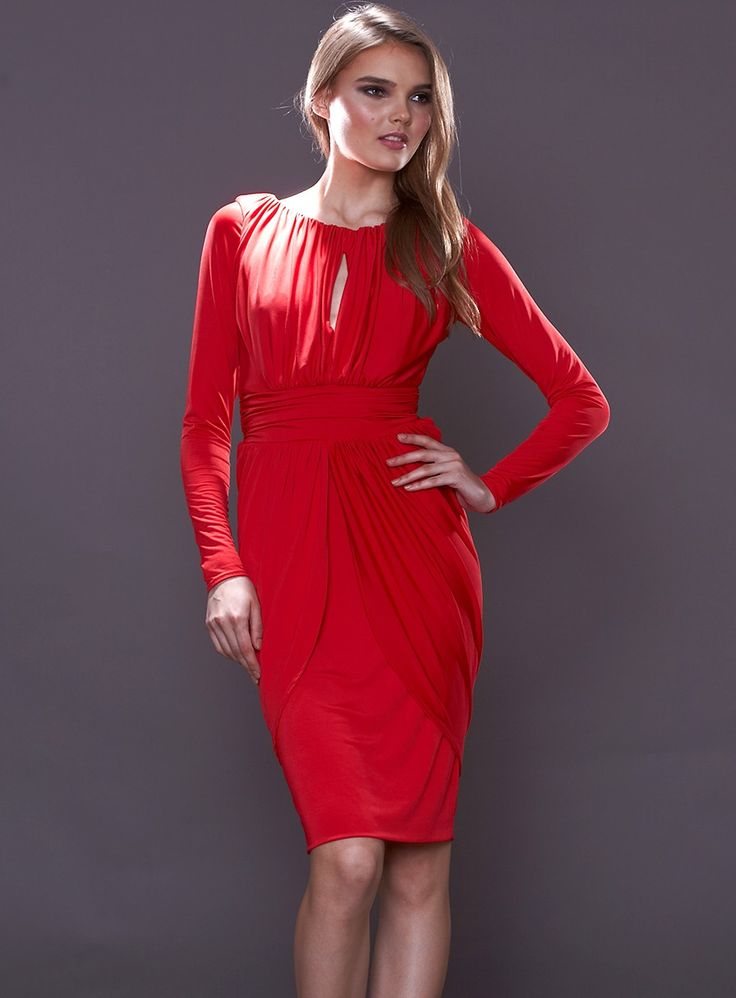 The Kendall Dress by Pia Gladys Perey is a stunning cocktail dress. Features a keyhole neckline, silky jersey draping and long sleeves. Avai...