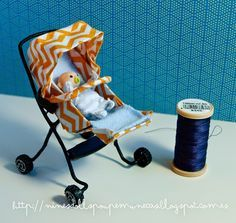 tutorial for how to make miniature, dollhouse-sized stroller - great pictures plus instructions to translate Tutorial Cotxet modern en miniatura Tutorial Stroller modern miniature Tutorial Cochecito moderno en miniatura Poussette Tutorial miniature moderne