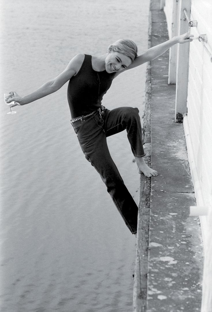 Edie. Hanging off a bridge. With a glass of wine. Simultaneously beautiful and tragic.