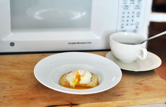 I don't usually use the microwave to poach my breakfast egg, but it can come in very handy for a lunch egg. Lentils, brown rice, or a salad can be elevated from a side dish to a main dish with a tender, gooey poached egg on top. Here's how to make a quick, freshly poached egg in the office microwave.