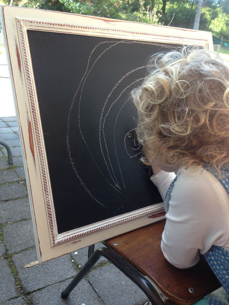 Old picture found at a garage/yard sale, painted over the original picture with blackboard paint.. Re painted and sanded back the frame .. Makes for a perfect transportable chalkboard for our granddaughter.