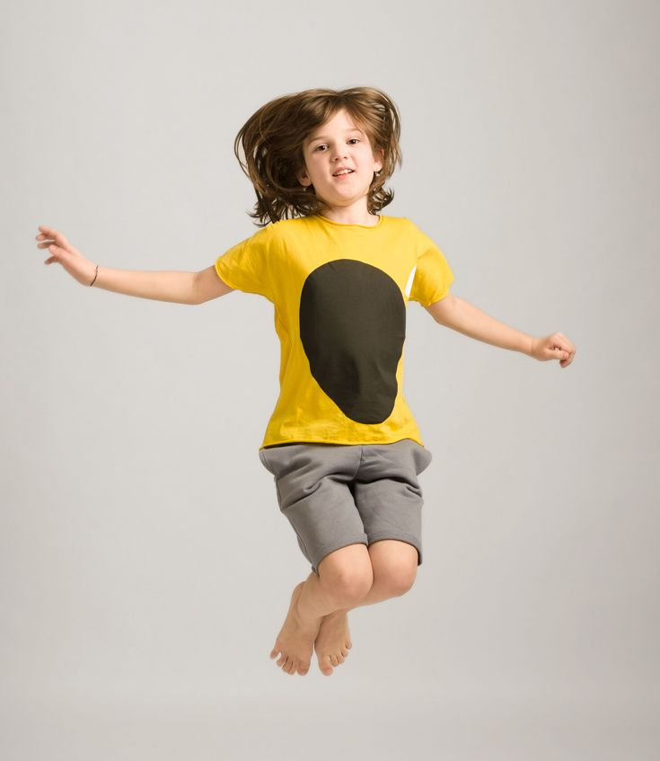 black oval  t-shirt gray shorts