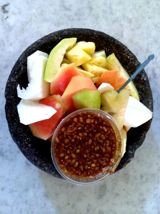 Fresh fruit rujak:  It is basically made of sliced fruits dipped in a rather sweet and spicy sambal (chili relish). (Pho...